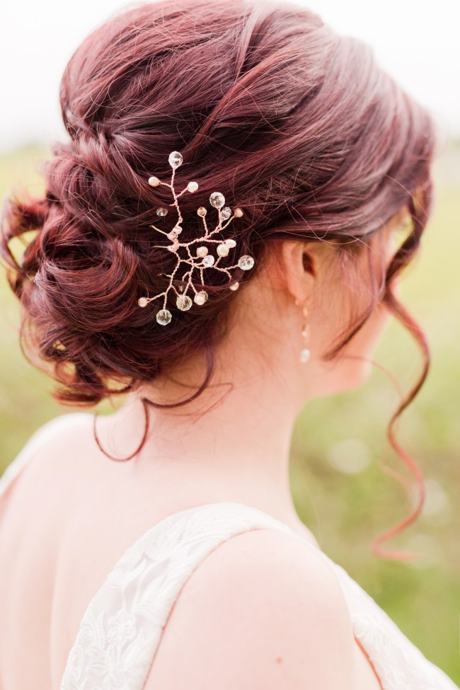 Bridal accessories guide: Low loose bridal updo with rose gold crystal hair vine