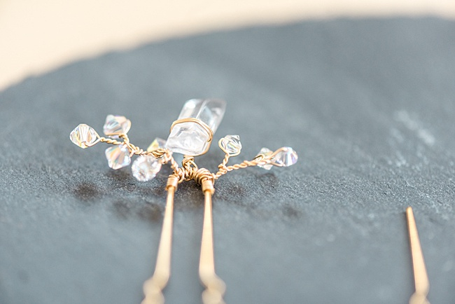 custom vintage inspired yellow gold bridal hairpin close up with raw crystal jadorn designs custom jewelry