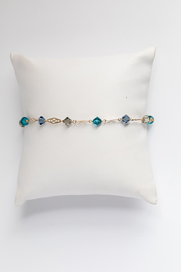 Delicate gold link and swarovski crystal bracelet in slate blue, teal, grey, and gold, handcrafted jewelry by J'Adorn Designs