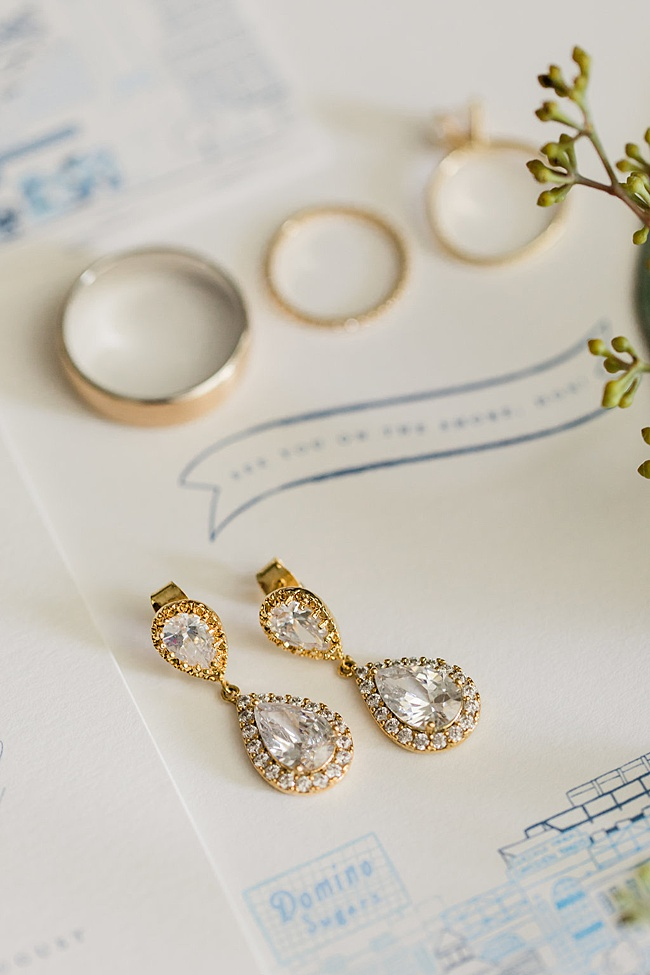 Classic wedding details featuring gold jewelry and artisan stationery in navy blue and white. Preppy nautical Annapolis wedding at Chesapeake Bay Beach Club featuring jewelry by J'Adorn Designs Maryland jewelry designer