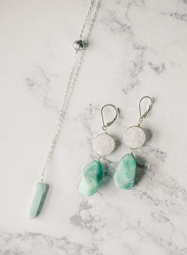 Sterling silver gemstone jewelry set by J'Adorn Designs featuring necklace and earrings. Necklace is an amazonite spike on a silver chain with grey freshwater pearl accent. Earrings are white druzy quartz with aqua amazonite drop stones with lever back earrings for comfort.
