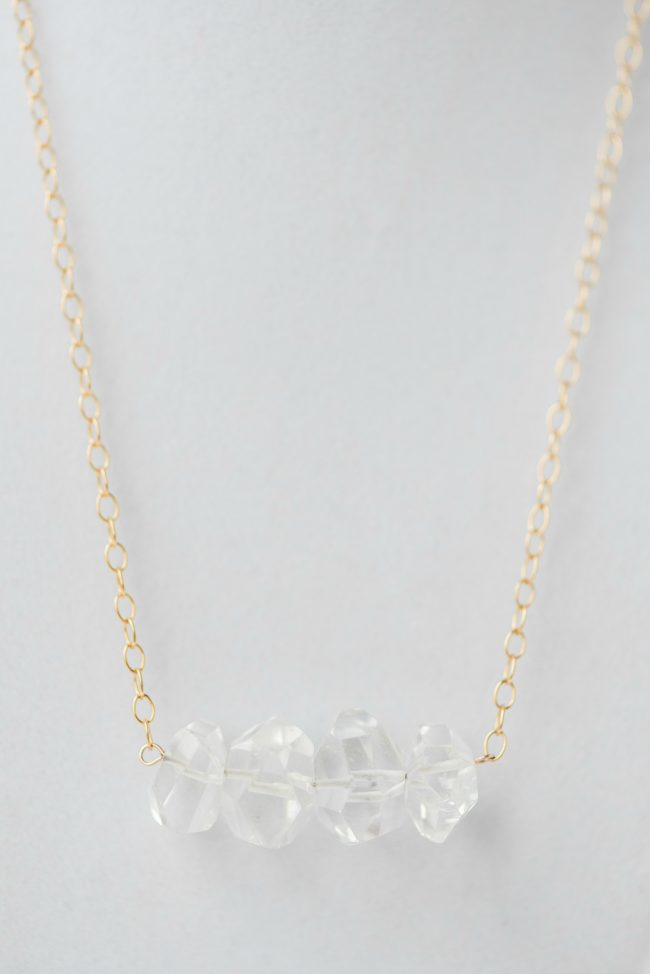 Mother's Day gifts: Modern neutral necklace from Betsy's Mother's Day gift wishlist: Crystal quartz bar necklace featuring four geometric crystal quartz beads on a delicate gold chain